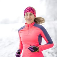 Woman out for a run in the winter snow to keep fit