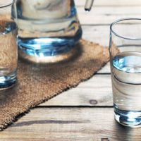 Glasses of water on a wooden table