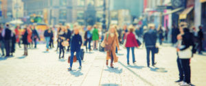 street of blurred busy people
