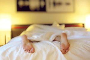 person in bed sleep apnoea
