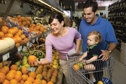 Family shopping for fruit at the supermarket