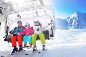 Healthy skiers on ski lift enjoying themselves