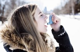 An Attractive young woman with asthma enjoying the winter outdoors