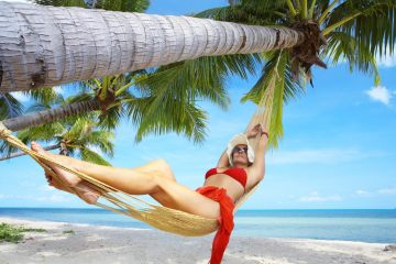 Healthy woman lounging in hammock on a tropical holiday