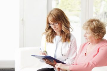 Senior woman in consultation with her doctor about a pap smear