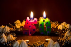 Closeup Of Candles On 50th Birthday Cake