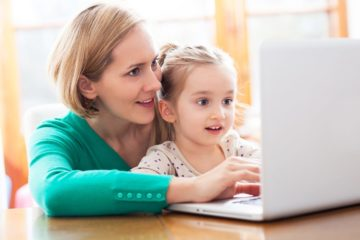 Mother and daughter using a laptop to surf the internet together