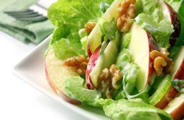 Waldorf salad with kos lettuce, crisp apple, celery, walnuts, spring onions, and a creamy dressing