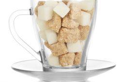 Lots of sugar cubes in glass mug
