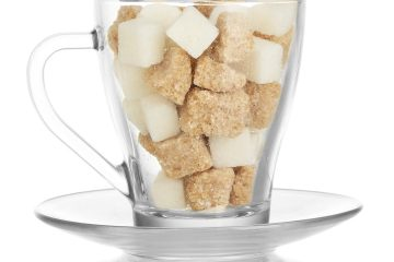 Lots of sugar cubes in glass mug