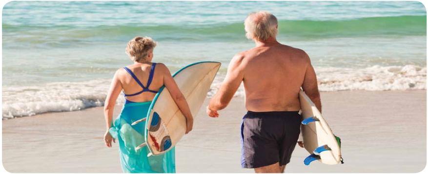 Older couple walking into the ocean