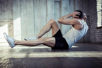 Young fit man undertaking a high intentisty interval training routine in a gym