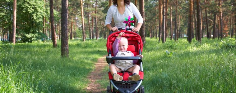 Mother enjoying some exercise pushing a baby in the stroller