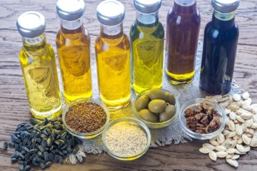 Bottles containing different varieties of cooking oil