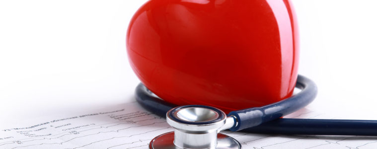 toy heart wrapped in stethoscope picture